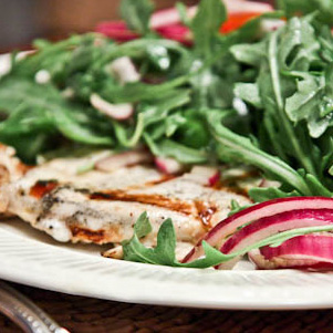 Lemon and Black Pepper Chicken Paillard with Arugula-Tomato Salad